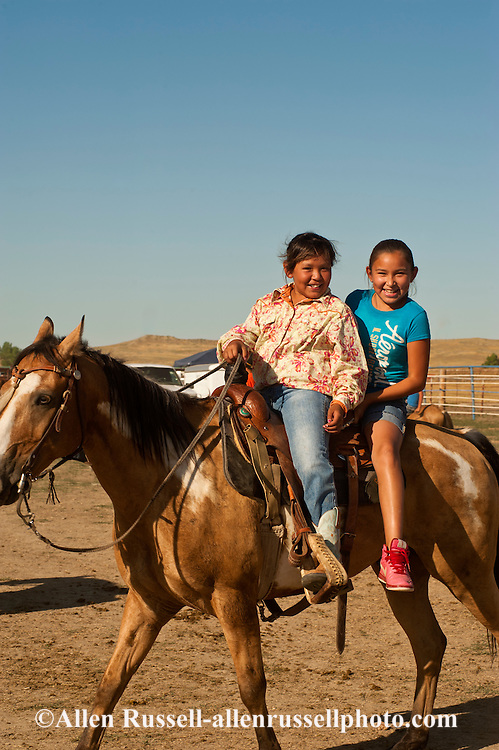 Indian, Native American, kids riding double, Crow Fair, Crow Indian Reservation, Montana