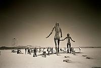 Metal art of mother & son in the Black Rock Desert.