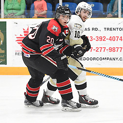 TRENTON, ON - Apr 18, 2016 -  Ontario Junior Hockey League game action between the against the Trenton Golden Hawks and the Georgetown Raiders. Game 3 of the Buckland Cup Championship Series, at the Duncan Memorial Gardens in Trenton, Ontario. Adam Clements #20 of the Trenton Golden Hawks battles for control with Kevin Lavoie #10 of the Trenton Golden Hawks during the second period.<br /> (Photo by Andy Corneau / OJHL Images)