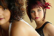 Models at a shoot for a magazine story on hair styles and makeup.  Winnipeg, Manitoba, Canada