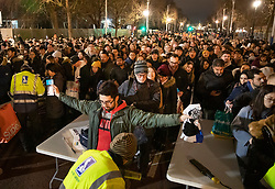 © Licensed to London News Pictures. 31/12/2018. London, UK. Crowds go through a security check on The Mall as they arrive to celebrate New Year's Eve in central London.  Over 100,000 people are attending London's ticketed fireworks display on the banks of the River Thames for New Year's Eve tonight. Photo credit: Peter Macdiarmid/LNP