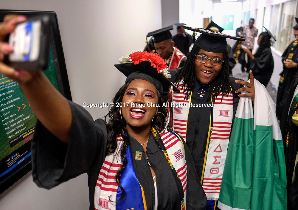 RIVERSIDE, CA - JUNE 11, 2017: Graduates Marjau Sauve, center, applies lipstick on Kayla Ross., left, before the Black Graduation Ceremony at University of California, Riverside, Sunday June 11, 2017. (Photo by Ringo H.W. Chiu / For The Times)(Photo by Ringo Chiu)<br /> <br /> Usage Notes: This content is intended for editorial use only. For other uses, additional clearances may be required.