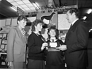 05/01/1989.01/05/1989.5th January 1989.The Aer Lingus Young Scientist of the Year Award at the RDS, Dublin ..Picture shows Michael Smith, T.D., Minister for Energy with Fiona Steed and Frances Quinn from St. Mary's Secondary School, Nenagh, Co. Tipperary at their project 'Greyhounds- A Hobby or an Enterprise'. Anne O'Reilly of Aer Lingus is also in picture.