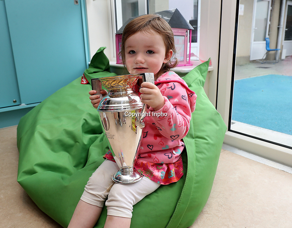 Women's Rugby World Cup Players Visit Our Lady&rsquo;s Children&rsquo;s Hospital Crumlin, Dublin 14/8/2017<br /> Ruby Shanon from Carlow (age 2) with the Women's Rugby World Cup trophy<br /> Mandatory Credit &copy;INPHO/Dan Sheridan