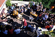 A group of people relaxing in the sun, Quart festival, Kristiansands Norway 2000