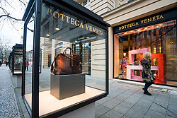 Glass display cabinet for luxury boutique Bottega Veneta  on famous shopping street Kurfurstendamm , Kudamm, in Berlin, Germany.