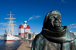 Detail of statue of folk singer Evert Taube at harbour in Gothenburg Sweden