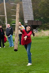 Chen Liu, Miss China during the caber tossing at the Miss World Highland Games..The Miss World 2011 contestants take part in a highland games in the grounds of Crieff Hydro, Perthshire..MISS WORLD 2011 VISITS SCOTLAND..Pic © Michael Schofield.