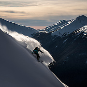 Suz Graham skis along a wind lip in the Whistler backcountry