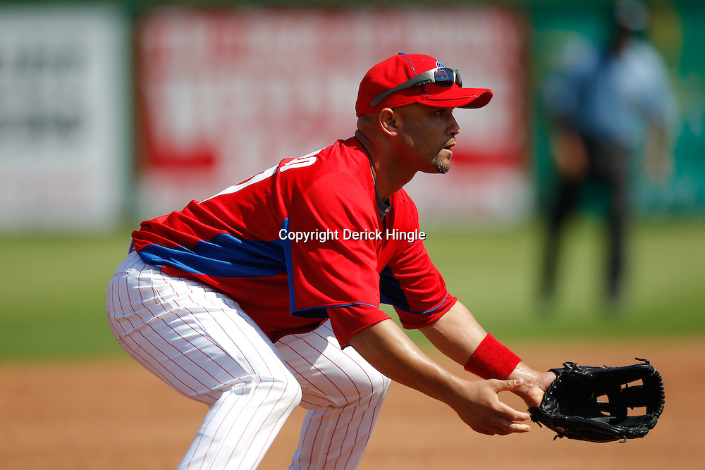 February 24, 2011; Clearwater, FL, USA; Philadelphia Phillies third baseman Placido Polanco (27) during a spring training exhibition game against the Florida State Seminoles at Bright House Networks Field. Mandatory Credit: Derick E. Hingle