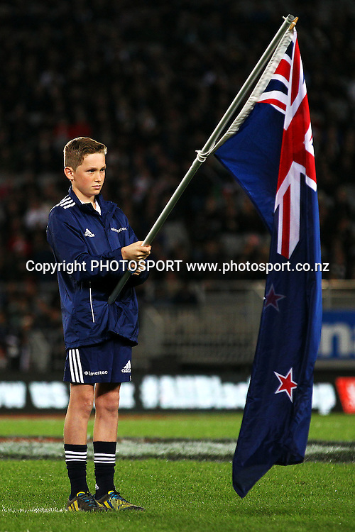 Flag bearer. 2014 Steinlager Series rugby union test match, All Blacks v England at Eden Park, Auckland, New Zealand. Saturday 7th June 2014. Photo: Anthony Au-Yeung / photosport.co.nz