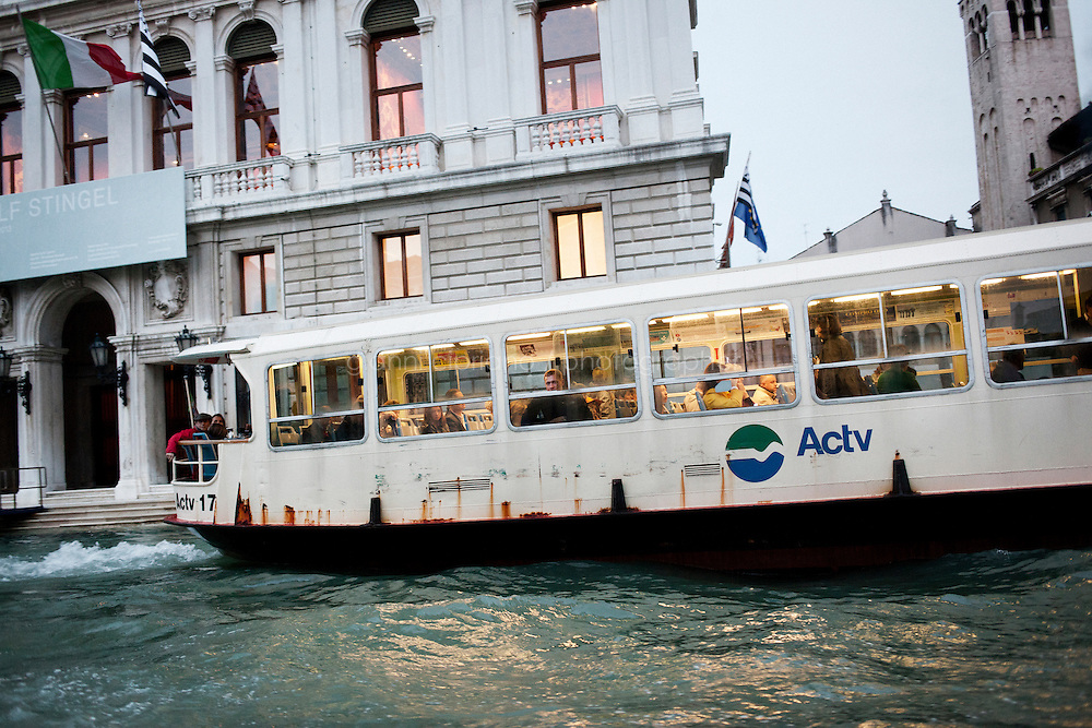 VENICE, ITALY - 31 MAY 2013: A passsenger ferry navigates in the Canal Grande in Venice, Italy, on May 31st 2013. <br /> <br /> <br /> The 55th International Art Exhibition of the Venice Biennale takes place in Venice from June 1st to November 24th, 2013 at the Giardini and at the Arsenale as well as in various venues the city. <br /> <br /> Gianni Cipriano for The New York TImes