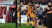 Hull celebrate their opener during the Sky Bet Championship match between Brentford and Hull City at Griffin Park, London, England on 3 November 2015. Photo by Michael Hulf.