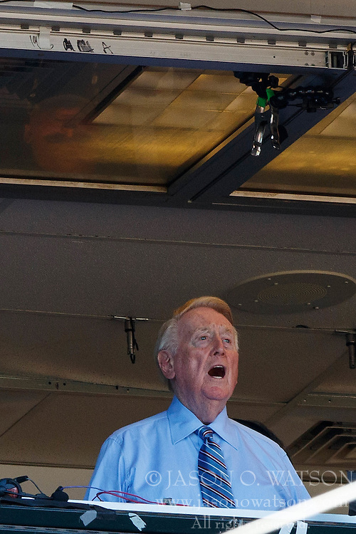 SAN FRANCISCO, CA - OCTOBER 02: Broadcaster Vin Scully sings Take Me Out to the Ballgame during the seventh inning between the San Francisco Giants and the Los Angeles Dodgers at AT&T Park on October 2, 2016 in San Francisco, California. The San Francisco Giants defeated the Los Angeles Dodgers 7-1. (Photo by Jason O. Watson/Getty Images) *** Local Caption *** Vin Scully