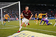 Scott Wharton scores a goal to make it 2-0 during during the EFL Sky Bet League 2 match between Northampton Town and Crewe Alexandra at the PTS Academy Stadium, Northampton, England on 16 November 2019.