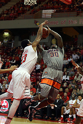 17 December 2014:  Deontae Hawkins rejects a shot by Twymond Howard during an NCAA Men's Basketball game between the Skyhawks of University of Tennessee - Martin and the Redbirds of Illinois State at Redbird Arena in Normal Illinois
