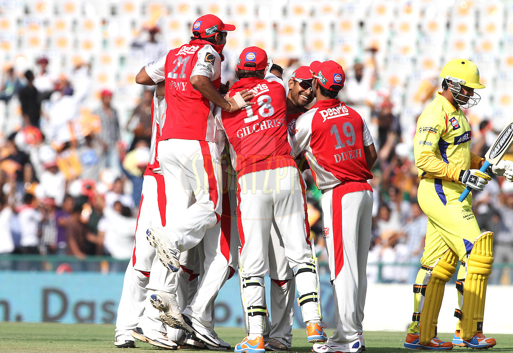 Kings XI Punjab congratulate Praveen Kumar of the Kings XI Punjab on trapping Aniruda Srikkanth of the Chennai Super Kings LBW off the first ball of the match during match 9 of the Indian Premier League ( IPL ) Season 4 between the Kings XI Punjab and the Chennai Super Kings held at the PCA stadium in Mohali, Chandigarh, India on the 13th April 2011..Photo by Shaun Roy/BCCI/SPORTZPICS