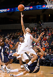 Virginia guard Britnee Millner (12) gets a shot off while being fouled.  The Virginia Cavaliers women's basketball team defeated the Monmouth Hawks 71-45 at the John Paul Jones Arena in Charlottesville, VA on December 18, 2008.