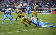 Jacksonville Jaguars tight end Julius Thomas (80) catches a pass and gets tackled by Tennessee Titans outside linebacker Brian Orakpo (98) and Tennessee Titans inside linebacker Wesley Woodyard (59) during the 2015 week 11 regular season NFL football game against the Tennessee Titans on Thursday, Nov. 19, 2015 in Jacksonville, Fla. The Jaguars won the game 19-13. (©Paul Anthony Spinelli)