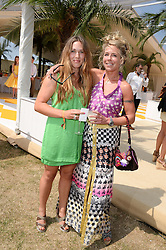 Left to right, ANNA HUMBER and COZMO JENKS at the Veuve Clicquot Gold Cup, Cowdray Park, Midhurst, West Sussex on 21st July 2013.