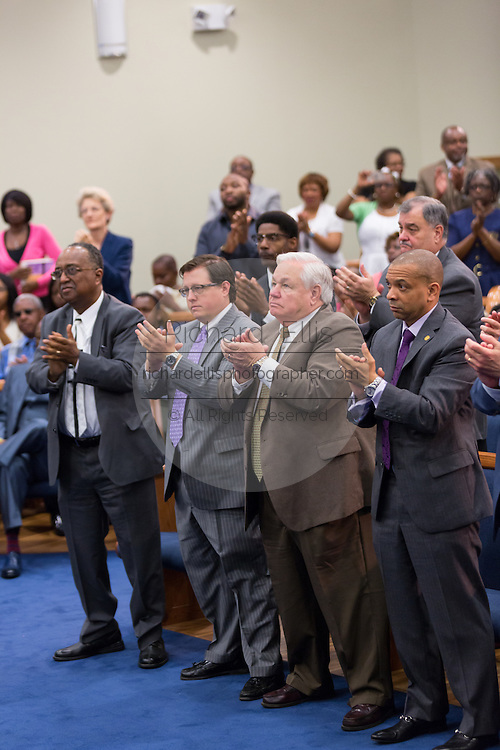 North Charleston Mayor Keith Summey applauds as Rev. Al Sharpton addresses a healing service at Charity Missionary Baptist Church April 12, 2015 in North Charleston, South Carolina. Sharpton spoke following the recent fatal shooting of unarmed motorist Walter Scott police and thanked the Mayor and Police Chief for doing the right thing in charging the officer with murder.
