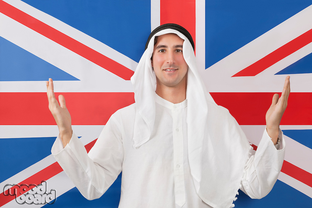Portrait of an Arab man in traditional clothes against American flag