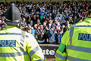 Sizeable police presence as the pitch invasion by both sets of fans is pushed back into the stands. The game is halted during the seconds half of the EFL Sky Bet League 1 match between Port Vale and Bolton Wanderers at Vale Park, Burslem, England on 22 April 2017. Photo by Mark P Doherty.