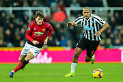 Victor Lindelof (#2) of Manchester United and Jose Salomon Rondon (#9) of Newcastle United chase after the loose ball during the Premier League match between Newcastle United and Manchester United at St. James's Park, Newcastle, England on 2 January 2019.