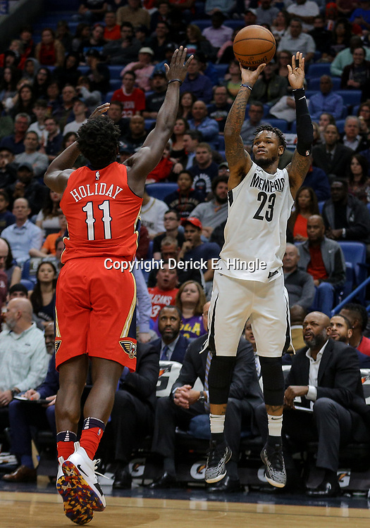 Apr 4, 2018; New Orleans, LA, USA; Memphis Grizzlies guard Ben McLemore (23) shoots over New Orleans Pelicans guard Jrue Holiday (11) during the second quarter at the Smoothie King Center. Mandatory Credit: Derick E. Hingle-USA TODAY Sports