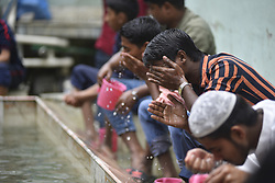 June 15, 2018 - Kathmandu, NP, Nepal - Nepalese Muslims washes their hands, face and feet before offering ritual prayers during last friday of Ramadan at Nepali Jame mosque at Kathmandu, Nepal on Friday, June 15, 2018. Ramadan (also known as Ramadhan or Ramzan) is the ninth month in the Islamic calendar. During the month of Ramadan, Muslims fast from dawn to dusk all over the world. While fasting from dawn until sunset, Muslims avoid from consuming food, drinking liquids, smoking, and engaging in sexual relations. (Credit Image: © Narayan Maharjan/NurPhoto via ZUMA Press)