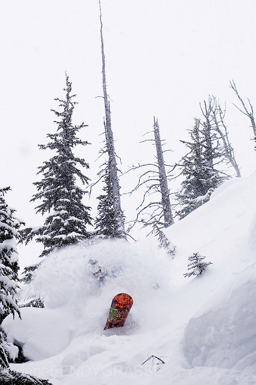 Professional Snowboarder Dave Short blasts through his own spray n a deep powder day on Whistler Mountain, British Columbia, Canada.