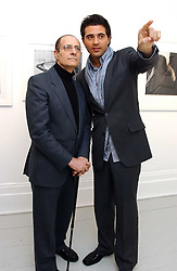 Left to right, BOOTH DANESH and his son Singer DARIUS DANESH at a private view of an exhibition of photographs by the late Robert Mapplethorpe curated by artist David Hockney at the Alison Jacques Gallery, 4 Clifford Street, London W1 on 13th January 2005.<br />