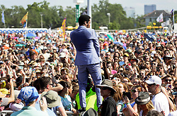 02 May 2015. New Orleans, Louisiana.<br /> The New Orleans Jazz and Heritage Festival. <br /> Ty Taylor of Vintage Trouble gets amongst the crowds the Genilly Stage.<br /> Photo; Charlie Varley/varleypix.com