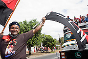 10 JANUARY 2007 - MANAGUA, NICARAGUA:  A Sandanista supporter waves Sandanista banners on his way to the inauguration of Daniel Ortega, the leader of the Sandanista Front, who was sworn in as the President of Nicaragua after winning a very close election. Ortega and the Sandanistas ruled Nicaragua aftet their victory over the Somoza regime in 1979 until their defeat by Violetta Chamorro in the 1990 election.  PHOTO BY JACK KURTZ