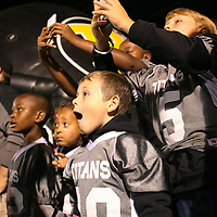 Lauren Wood | Buy at photos.djournal.com<br /> Ashton Collum, 6, center, watches the helicopter land at midfield to deliver the game ball with his Pontotoc Youth Football team, the Pontotoc Titans, before the start of Friday night's game at Pontotoc.