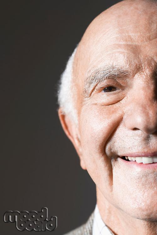 Senior man in studio close up