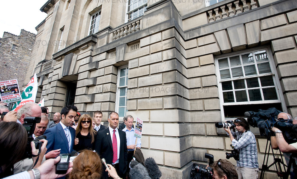 Former Socialist MSP Tommy Sheridan and his wife Gail leave Edinburgh High Court where he is facing perjury charges...His lawyer Amar Anwar reads a statement to the press....Picture Michael Hughes/Maverick.