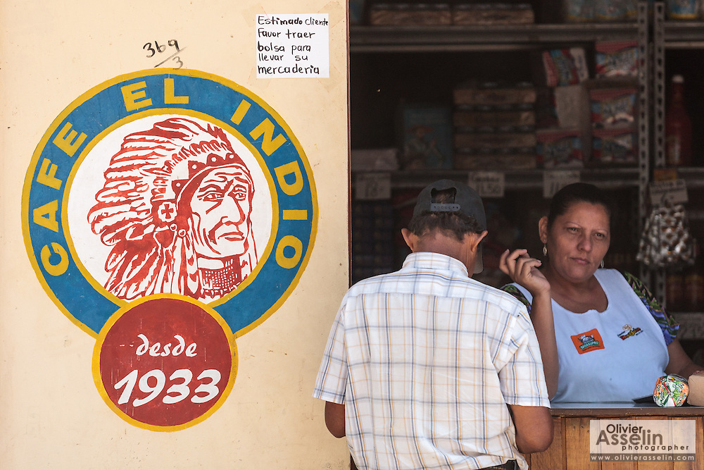 A customer shops at a food store in the town of San Esteban, Honduras on Wednesday April 24, 2013.