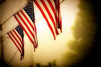 Lisa Johnston | lisa@aeternus.com | Tiwtter: @aeternusphoto Three American Flags on a city street