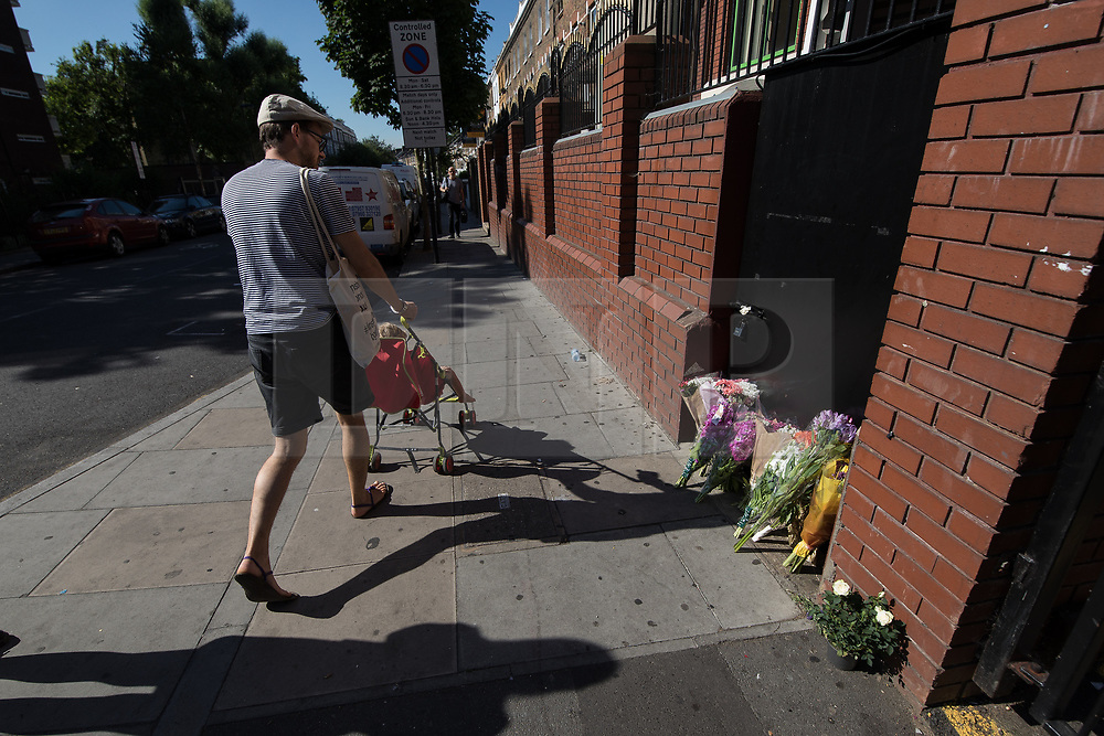 © Licensed to London News Pictures. 19/06/2017. London, UK. Flowers left in memory of the dead and injured , outside Finsbury Park Mosque . One man is known to be dead and several inured after a hired van was driven in to people on Whadcoat Street in Finsbury Park in North London after late night prayers at a nearby mosque . Photo credit: Joel Goodman/LNP