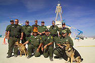 "BLACK ROCK CITY, NV:  Federal Bureau of Land Management Rangers in front of ""The Man"" in Black Rock City, Nevada.  The rangers form part of a larger force that fulfills the same function as police in any city."