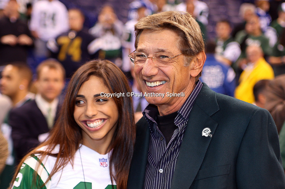 Former New York Jets quarterback Joe Namath smiles and poses for a photo with his daughter before the current day New York Jets AFC Championship football game against the Indianapolis Colts, January 24, 2010 in Indianapolis, Indiana. The Colts won the game 30-17. ©Paul Anthony Spinelli