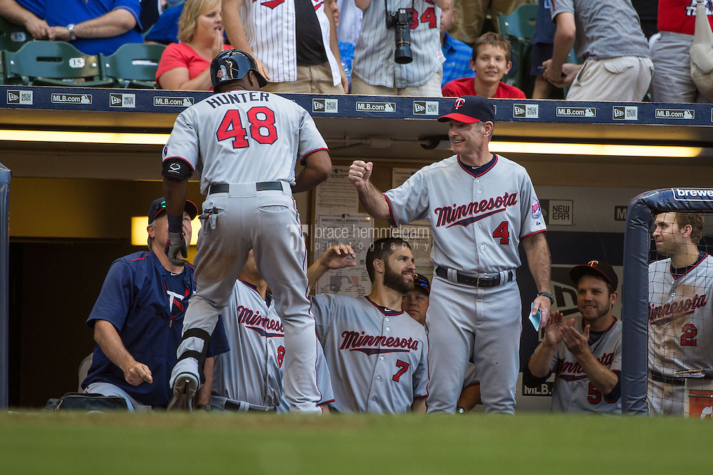 MILWAUKEE, WI- JUNE 27: Torii Hunter #48 of the Minnesota Twins celebrates with Paul Molitor #4 hitting a home run against the Milwaukee Brewers on June 27, 2015 at Miller Park in Milwaukee, Wisconsin. The Twins defeated the Brewers 5-2. (Photo by Brace Hemmelgarn) *** Local Caption *** Torii Hunter;Paul Molitor