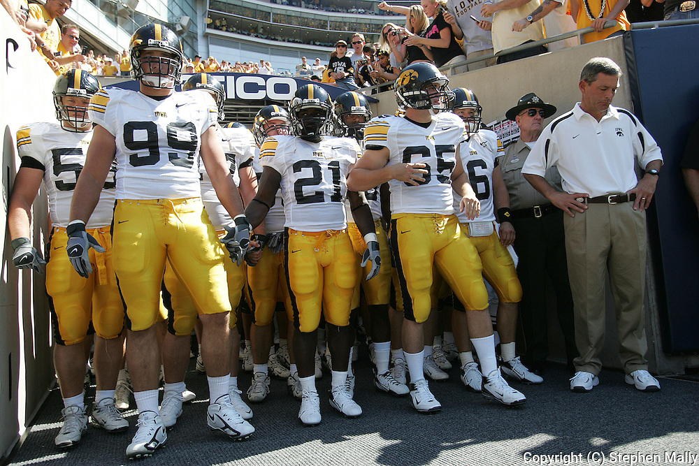 01 SEPTEMBER 2007: Iowa defensive end Bryan Mattison (99), running back Albert Young (21), safety Daniel Olszta (65) and head coach Kirk Ferentz (from left) stand in the tunnel before taking the field at the beginning of Iowa's 16-3 win over Northern Illinois at Soldiers Field in Chicago, Illinois on September 1, 2007.