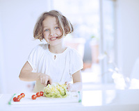 Young girl making a salad