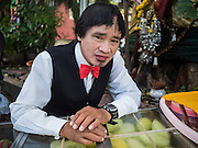 24 SEPTEMBER 2015 - BANGKOK, THAILAND:  A fruit vendor with a vest and bowtie near the French Embassy in the Bang Rak district of Bangkok.     PHOTO BY JACK KURTZ