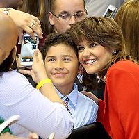 Annette Taddeo poses with a supporter during a campaign event on Monday, Nov. 3, 2014, at the UCF Arena in Orlando, Fla. Crist, a former Florida Republican governor, and running mate Taddeo is running against Republican Florida Gov. Rick Scott.  (AP Photo/Alex Menendez)