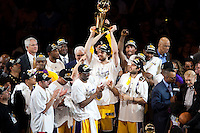 17 June 2010:  Forward Pau Gasol of the Los Angeles Lakers holds up the Larry O'Brien trophy and celebrates with his team after the Lakers defeat the Boston Celtics 83-79 and win the NBA championship in Game 7 of the NBA Finals at the STAPLES Center in Los Angeles, CA.