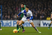 Bristol Rovers Defender, Daniel Leadbitter (2) holds off Scunthorpe United Forward, Tom Hopper (14) during the EFL Sky Bet League 1 match between Bristol Rovers and Scunthorpe United at the Memorial Stadium, Bristol, England on 25 February 2017. Photo by Adam Rivers.
