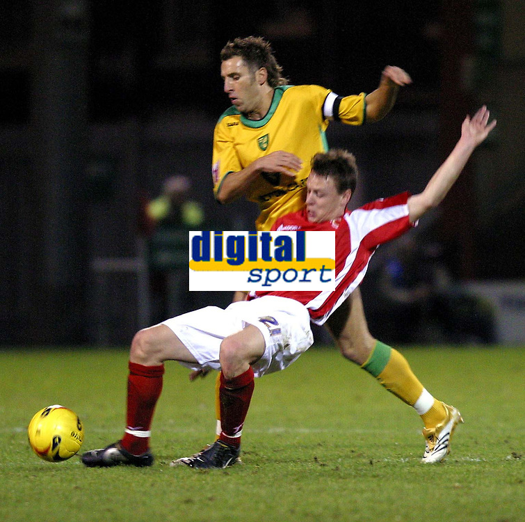 Photo: Dave Linney.<br />Crewe Alexandra v Norwich City. Coca Cola Championship.<br />10/12/2005.Darren Huckerby(Norwich) keeps the pressure on   Gary Roberts(Crewe))